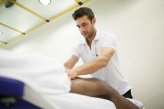 Physiotherapist applying massage stock images