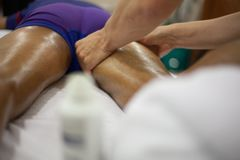 Physiotherapist applying massage stock photo