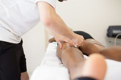 Physiotherapist applying massage stock images