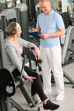 Physiotherapist assist active senior woman at gym Royalty Free Stock Photos