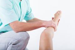 Physiotherapist bending knee Royalty Free Stock Photo