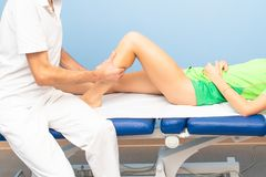 Physiotherapist during a calf massage to an athlete stock photography