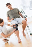 Physiotherapist checking man with crutches Stock Photography