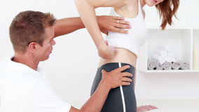 Physiotherapist checking patients hip stock video
