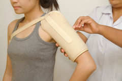 Physiotherapist checking woman's  shoulder Stock Photo