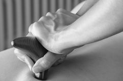 Physiotherapist / chiropractor doing a back massage royalty free stock photos