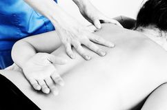 Physiotherapist, chiropractor giving a massage and stretching of stock images