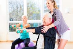 Physiotherapist coaching senior people Royalty Free Stock Photo