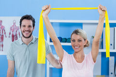 Physiotherapist correcting position of female patient Royalty Free Stock Image