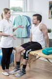 Physiotherapist discussing medical treatment Stock Photo