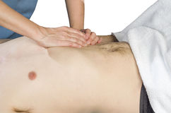 Physiotherapist is doing an activation of the diaphragm. Massage. To a man patient Royalty Free Stock Photo