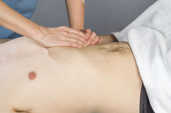 Physiotherapist is doing an activation of the diaphragm. Massage Stock Photo