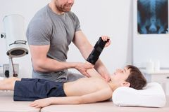 Physiotherapist doing arm exercise Stock Photo