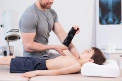 Physiotherapist doing arm exercise Stock Photo
