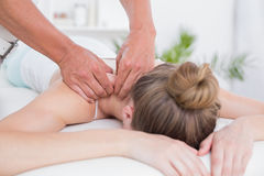 Physiotherapist doing arm massage to his patient Stock Image