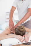 Physiotherapist doing arm massage to his patient Royalty Free Stock Photo
