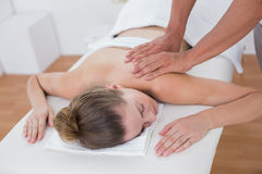 Physiotherapist doing arm massage to his patient Royalty Free Stock Images