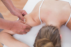 Physiotherapist doing arm massage to his patient Stock Photos