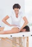 Physiotherapist doing back massage Royalty Free Stock Image