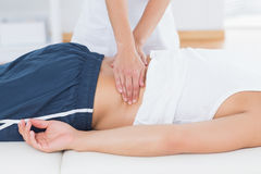 Physiotherapist doing back massage Stock Image