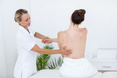 Physiotherapist doing back massage Royalty Free Stock Photos