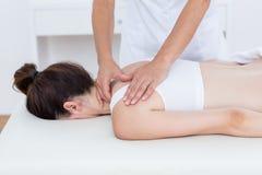 Physiotherapist doing back massage Stock Photography
