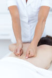 Physiotherapist doing back massage Royalty Free Stock Photography