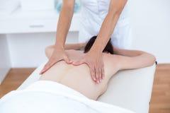 Physiotherapist doing back massage Royalty Free Stock Images