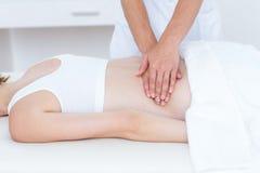Physiotherapist doing back massage Stock Images