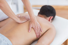 Physiotherapist doing back massage to her patient royalty free stock photos