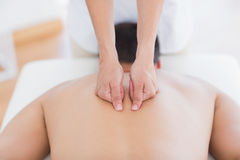 Physiotherapist doing back massage to her patient Stock Photography