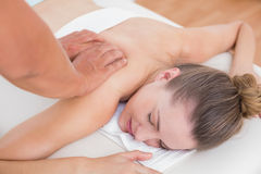 Physiotherapist doing back massage to his patient Stock Photos