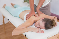 Physiotherapist doing back massage to his patient Royalty Free Stock Photos