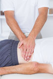 Physiotherapist doing back massage to his patient Stock Photo