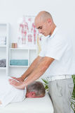 Physiotherapist doing back massage to his patient Royalty Free Stock Image