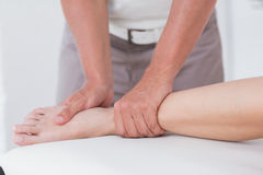 Physiotherapist doing calf massage Royalty Free Stock Images
