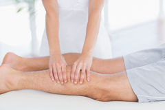 Physiotherapist doing calf massage to her patient Royalty Free Stock Images
