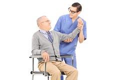 Physiotherapist doing an exam on senior gentleman Stock Photo
