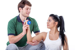 Physiotherapist doing exercise with his patient Stock Photos