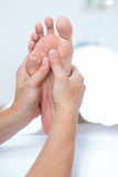 Physiotherapist doing foot massage Stock Images