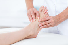 Physiotherapist doing foot massage Stock Photography