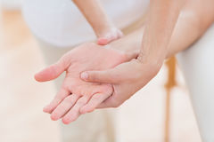 Physiotherapist doing hand massage Stock Photo
