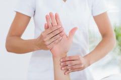 Physiotherapist doing hand massage Royalty Free Stock Photo