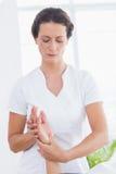 Physiotherapist doing hand massage Stock Photography