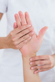 Physiotherapist doing hand massage Royalty Free Stock Photography