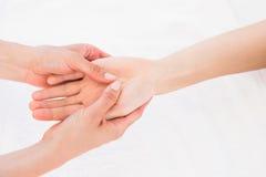 Physiotherapist doing hand massage Stock Image