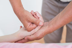 Physiotherapist doing hand massage Royalty Free Stock Images