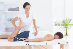 Physiotherapist doing leg massage Stock Photography