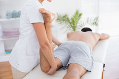 Physiotherapist doing leg massage to her patient Stock Photo
