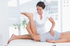 Physiotherapist doing leg massage to her patient Royalty Free Stock Image